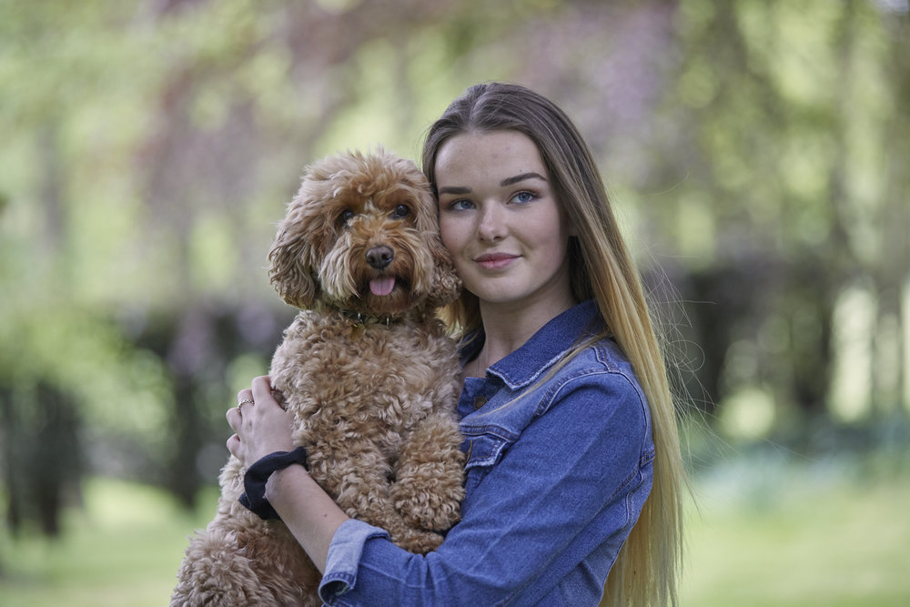 Generation Z pet parent, 17-year-old Roxy Carr, from Bournemouth, and her Cockapoo, Poppy.jpg