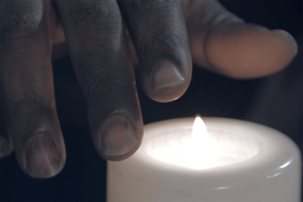 phoebe_nightingale_stay_the_burning_short_film_experimental_ronke_adekoluejo_hand_over_candle.jpg
