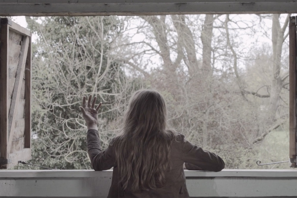 phoebe_nightingale_stay_the_burning_short_film_experimental_emma_in_window.jpg