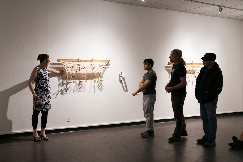 Erin King delivering her artist talk during her MFA Solo Exhibition,  Musica Universalis .