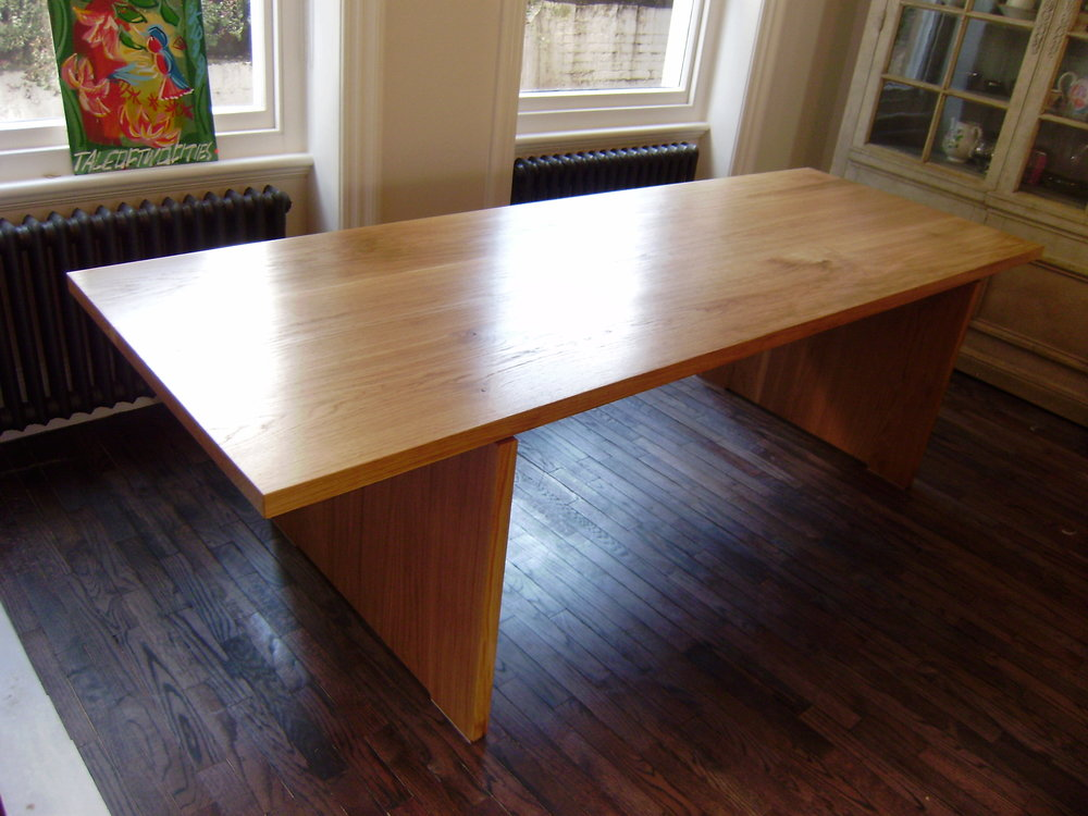 Solid Oak Table - Made from reclaimed oak, this table comfortably seats twelve.