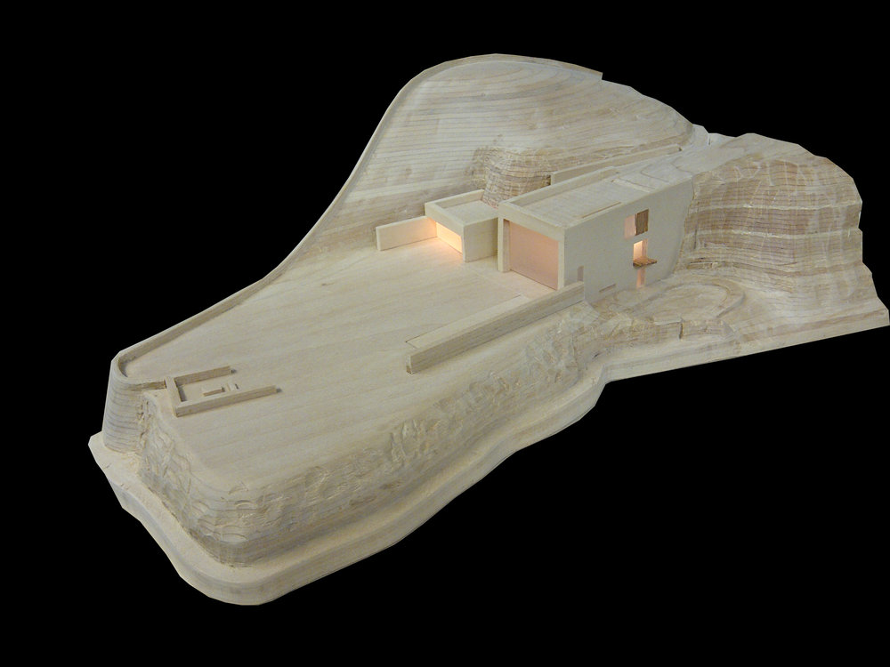 - This model, built for an architect, shows a proposed building nestled into the side of a rocky Cornish hill.