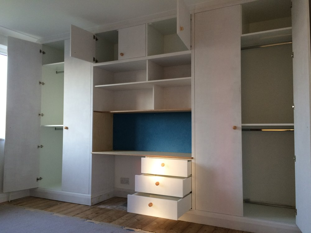 - Storage consists of both full and half height hanging, general storage above, with drawers and bookshelves to the desk area.