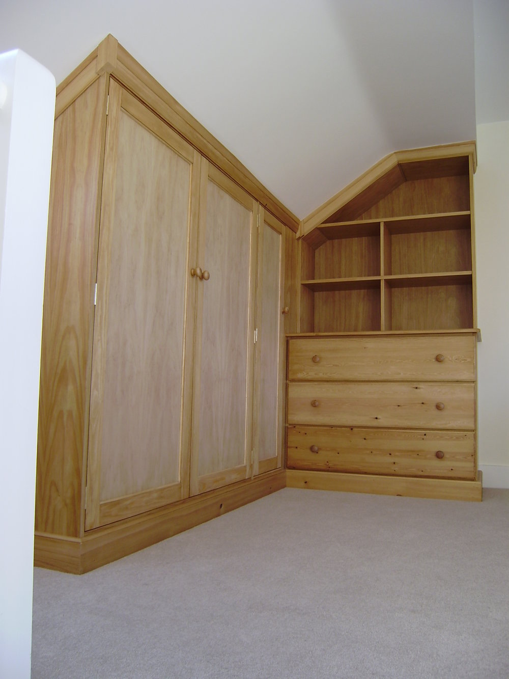 - These wardrobes were fitted in to a loft conversion. Made from pine, they matched existing furniture that my client already owned.