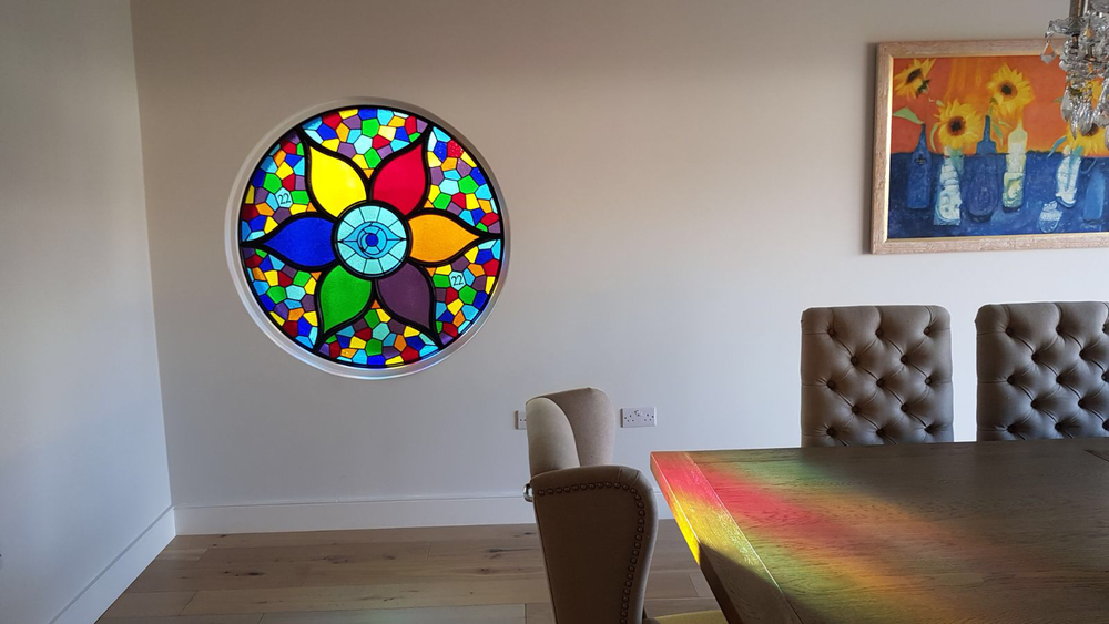 - This amazing window was completed in collaboration with Peacocks stained glass. The client inherited a steel fixture which Peacocks filled with stained glass. It was my job to make a circular frame to hold everything in place.