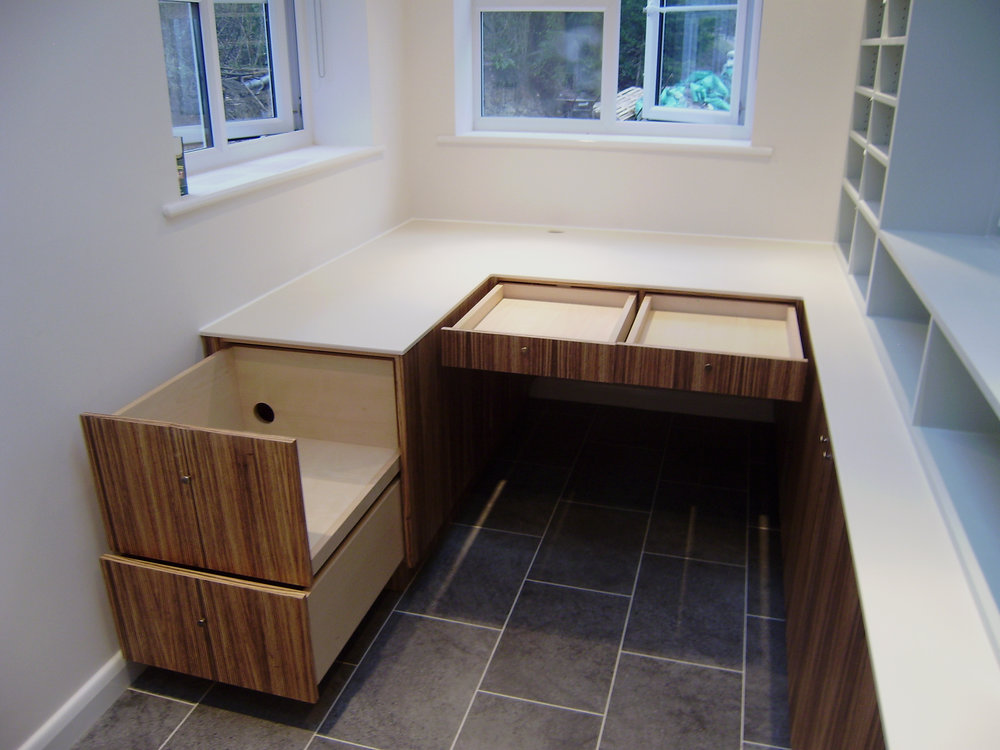 - The large drawers to the left are designed to house a printer and paper. This means that apart from a computer monitor, little else needed to be placed on the work surface.