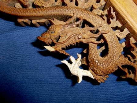 - Carving repairs to a dragon. The foot is around the size of a five pence piece and awaits colour and polish.