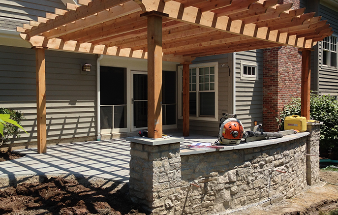 The completed hardscape with 18' x 19' pergola overhead adding shade and intimacy.