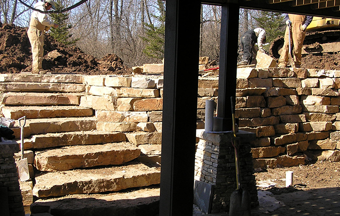 The steps are complete with the wall over 7 feet tall and still going up.