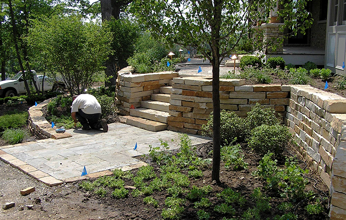 Irrigation and lighting are installed near the completed bluestone landing and steps leading to the garage.
