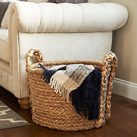 Both rustic and charming, the Household Essentials Large Wicker Floor Basket with Braided Handles is a sizeable basket with ample storage that is perfect as a blanket basket, a playroom organizer, or even an alternative hamper.