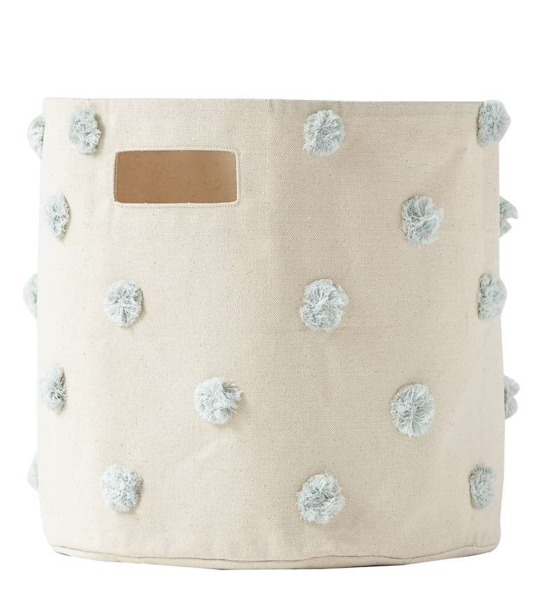 Declutter and update your décor with this durable cotton-canvas bin covered in tonal pompoms that holds your little one's toys, books, clothes or craft supplies. Put it in any room in the home to help keep your family organized.