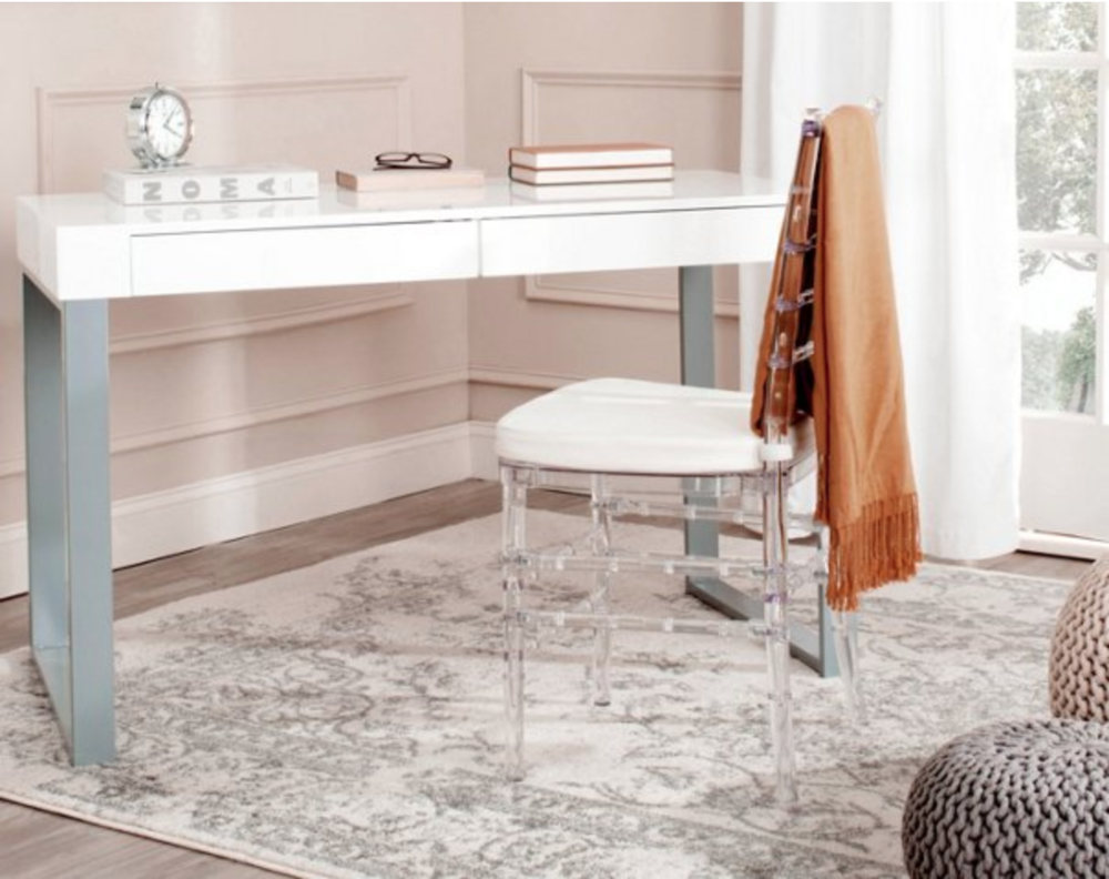 Designed with a sleek, clean-lined silhouette, this desk features a chic white top surface on gray iron legs. Two drawers offer plenty of space for notepads, pens, and other office essentials.