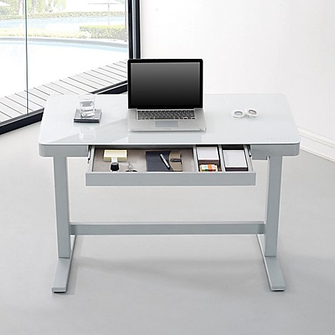 Upgrade your work space with a cool, modern Bell'O Adjustable Height Desk. With programmable height settings, an operating motor smoothly adjusts with the touch of a button on the glass top. Built-in USB ports allow you to charge up to 3 devices at once.