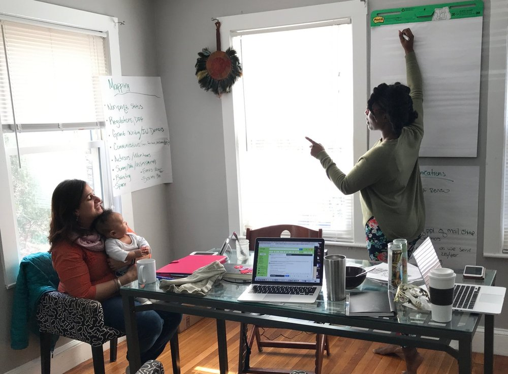 join us! - We are a group of parents, midwives, and public health practitioners called to action to integrate a freestanding birth center into Boston's health care landscape. We are reimagining, with the community, a beautiful space where pregnancy, labor, and birth are honored as natural and celebrated.Pictured here: Team members Meenakshi and Erline working on the strategic vision, supervised by Nashira's 4month old baby.