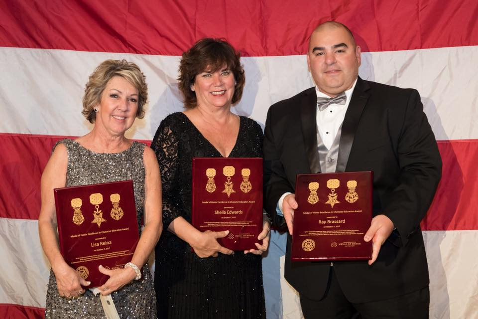 Lisa Reina, Sheila Edwards, and Ray Brassard receiving the Medal of Honor Excellence in Character Education Award on October 7th, 2017. Lisa and Sheila were the recipients of the Middle School Award. Ray was the recipient of the High School Award. This was the first time that the Congressional Medal of Honor Foundation had given this award. Lisa and Sheila teach in Covina, CA and Ray teaches and coaches in Puyallup, WA.