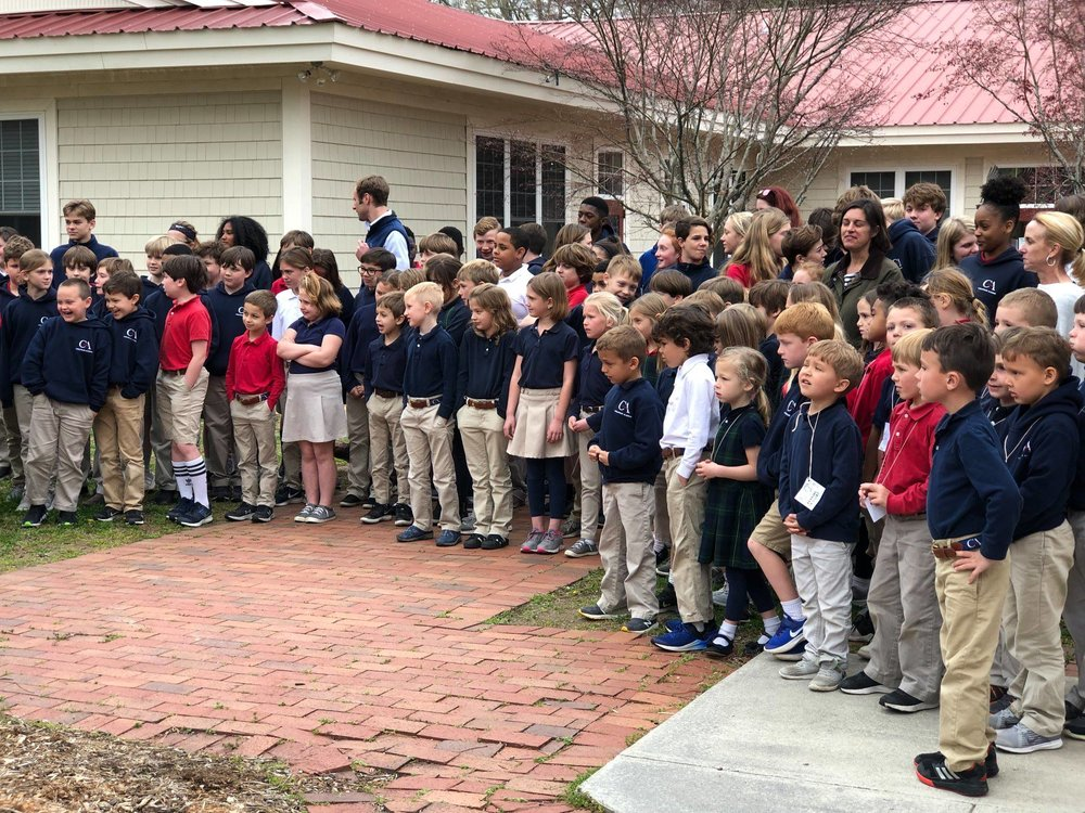 Students gather to witness the ground breaking.