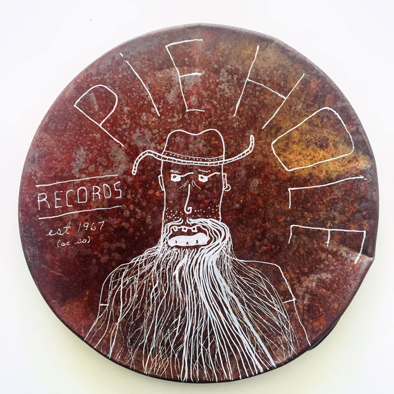 'Pie Hole Records.' Pen and ink on found rusted metal.