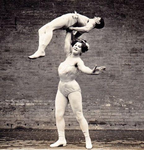 woman lifting man.jpg