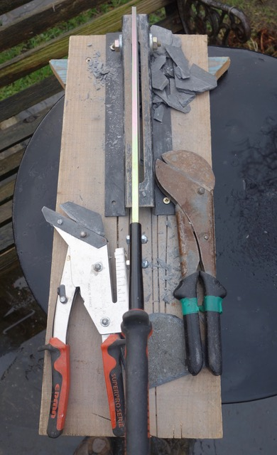 Tools used -central small slate cutting guillotine with French slate scissors (left) and Welsh slate scissors(right)
