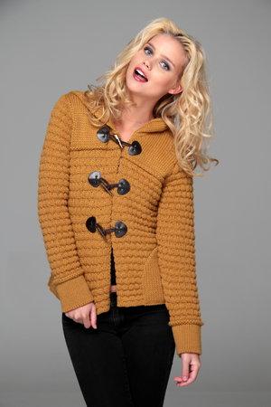 Cute model posing cozy in her hooded sweater