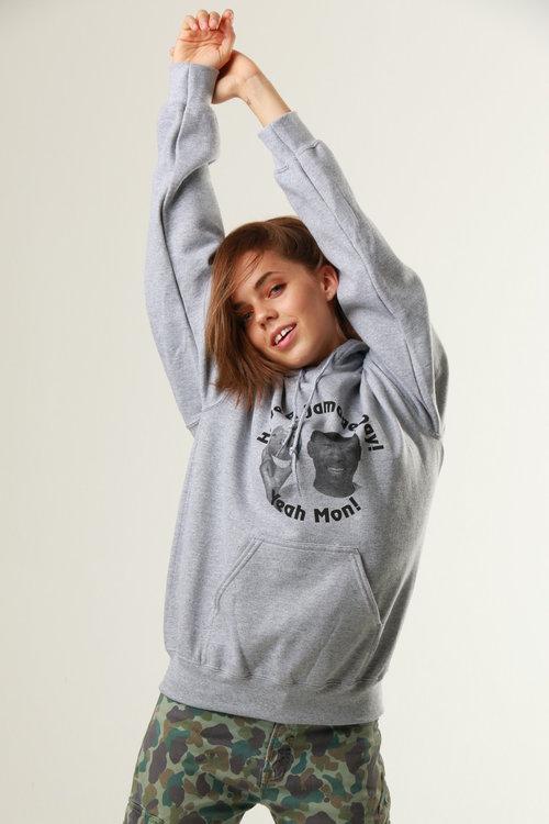 Adorable model posing in grey hoody