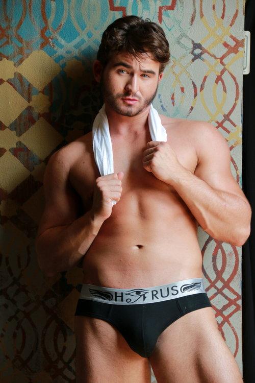 Male model posing in underwear on the Window Wall