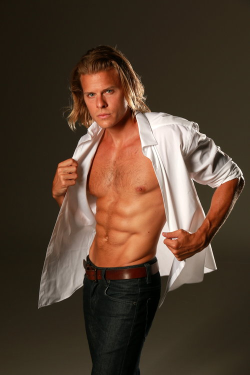 Male model posing with backdrop
