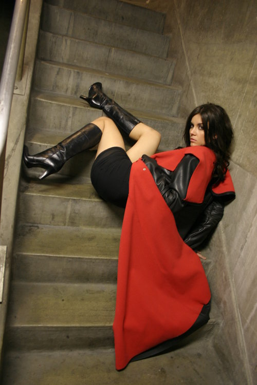 Seductive model posing in a stairwell