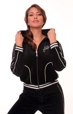Model posing in black sweatsuit