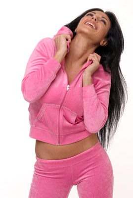 Model posing in pink sweatsuit