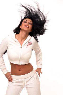 Model posing in white sweatsuit