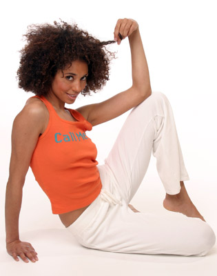Model posing in orange tank top