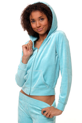 Model posing in blue sweatsuit