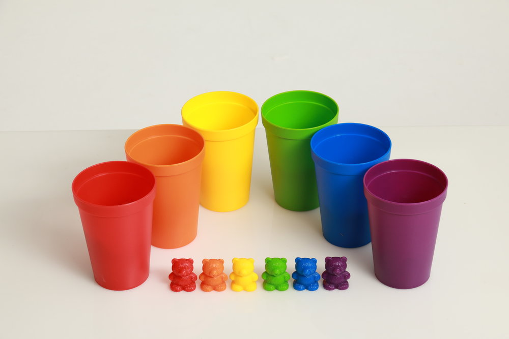 Photo of plastic cups with mini plastic bears lined up in front ecommerce