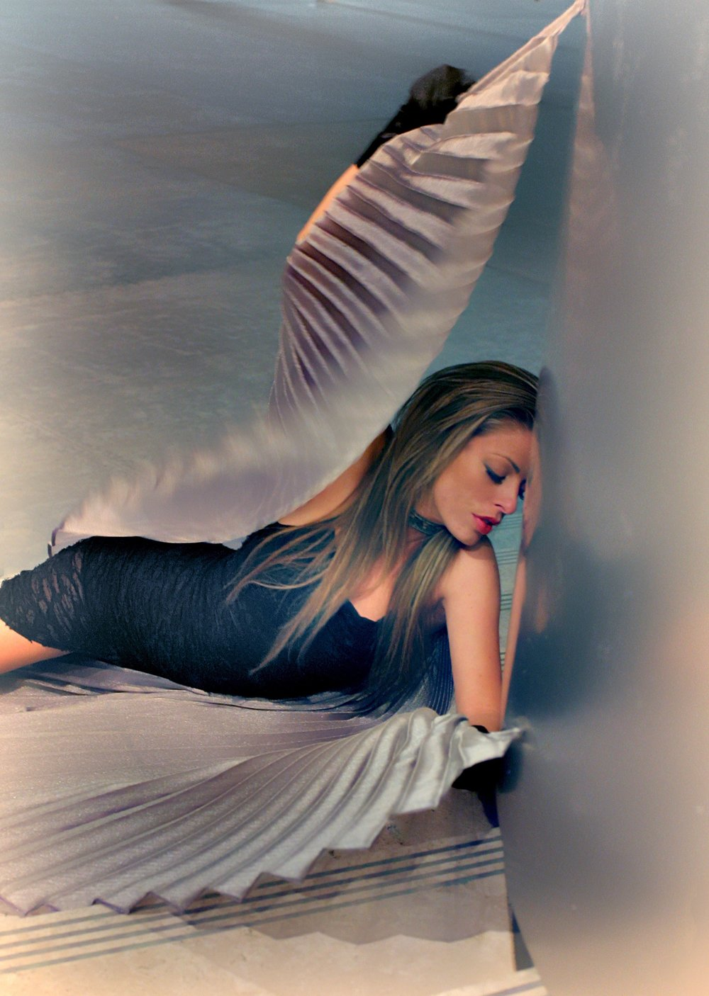 Music Artist posing with angel wings
