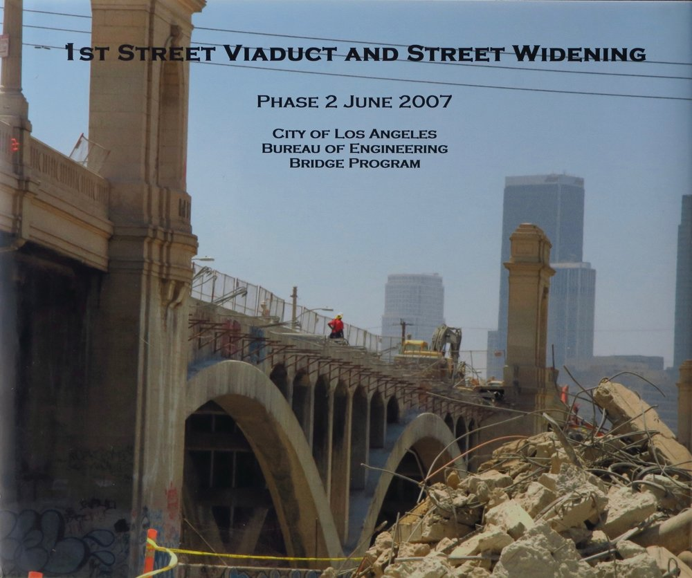 Book cover displaying progress, month to month, of construction at the 1st street viaduct and street widening