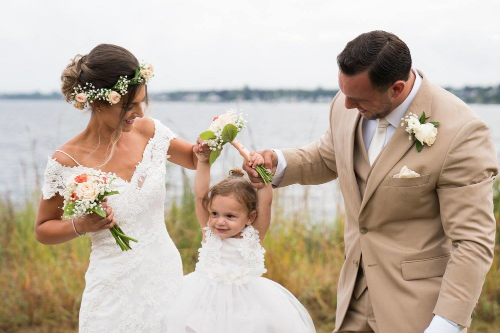 Kelsey & Lou - Sept.2017 - Is this not the most beautiful flower crown you've ever seen? Kelsey was a stunning bride; that dress, the hair, the flower crown...But their daughter stole the show (sorry Kels)I mean, how cute is she?Kelsey had a gorgeous vision for her wedding, her very, very fast wedding. She planned this and pulled it off in about a month! Kudos, Kelsey! You make the rest of us look bad, in more ways than one!They wed in early September, 2017 at Save The Bay - Narragansett Bay in Providence, RI.Photos by Mac Olink Visual Media; Hair and makeup by Sarah Depault