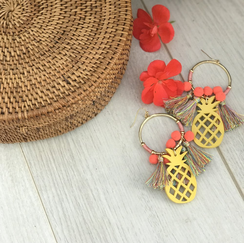 Pineapple earrings are always a YES! How fun are these with the multi-colored tassels and coral pom poms. The best part are these are 2 for $30 at Express. You can get one pair completely free!   Earrings  Express