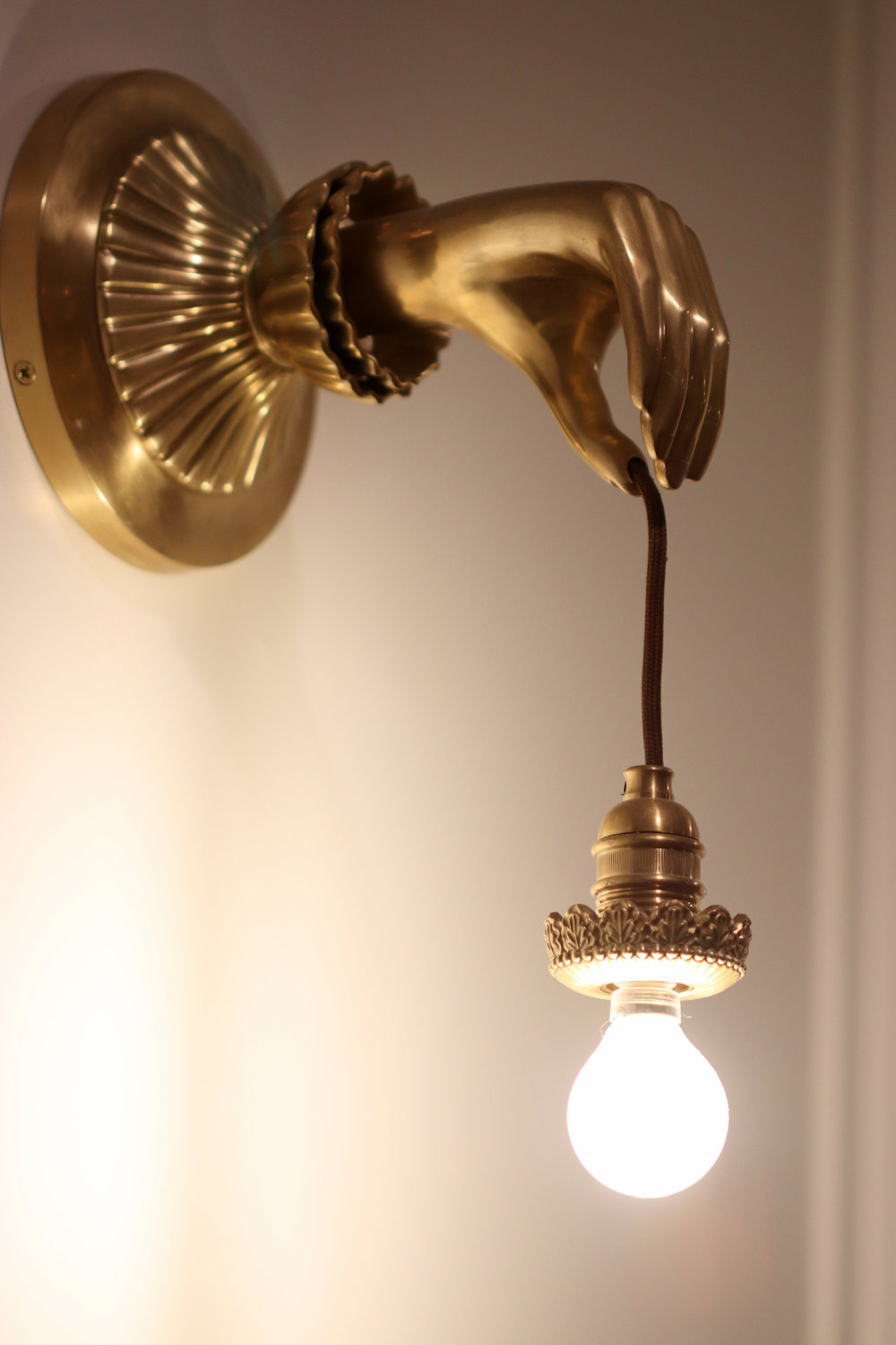 The coolest light fixture EVER hangs in the dinning room. I must find this and have one immediately!