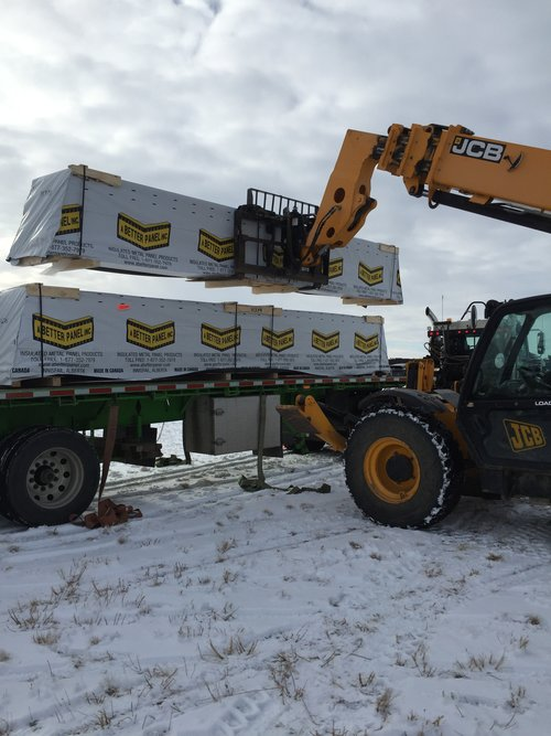 Exterior wall panels off-loaded