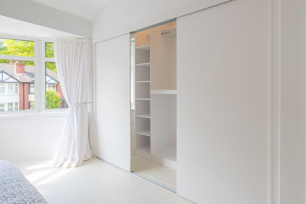 White sliding wardrobes