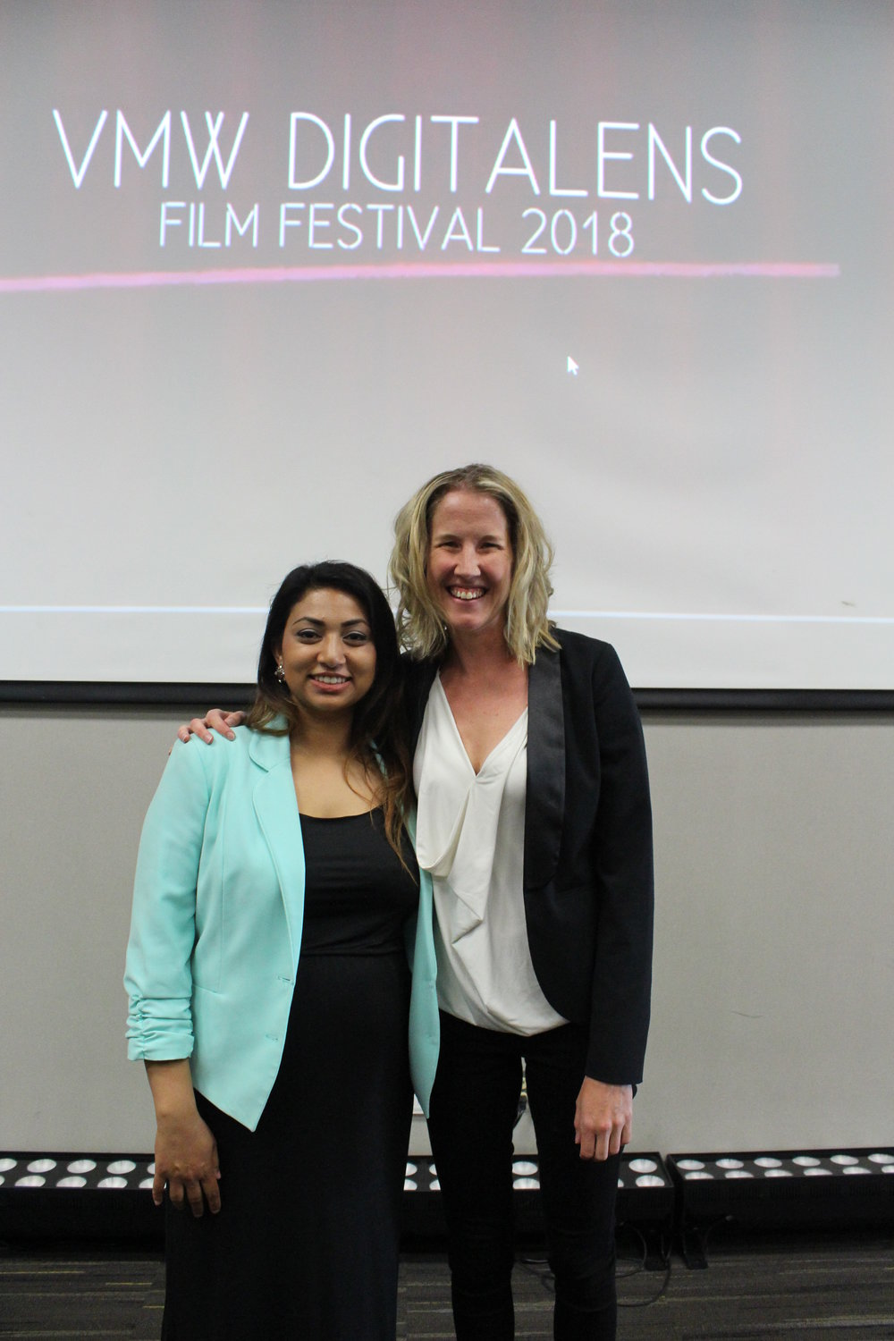 Director of the Visual Media Workshop, Katie Warfield, and Instructor and Program Manager of the Visual Media Workshop, Aisha Amijee, at the VMW DigitaLENS Film Festival.