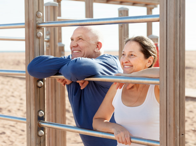 mature-couple-together-near-sports-equipment_1398-4002.jpg