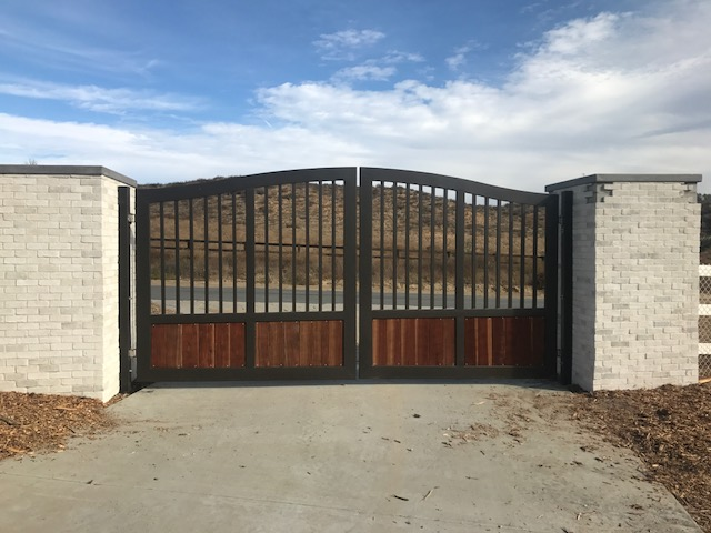 AAV Custom Gates - Iron with wood paneling.JPG