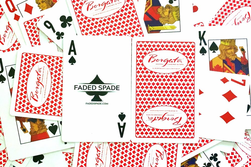 faded spade poker playing cards are in play at the borgata poker room