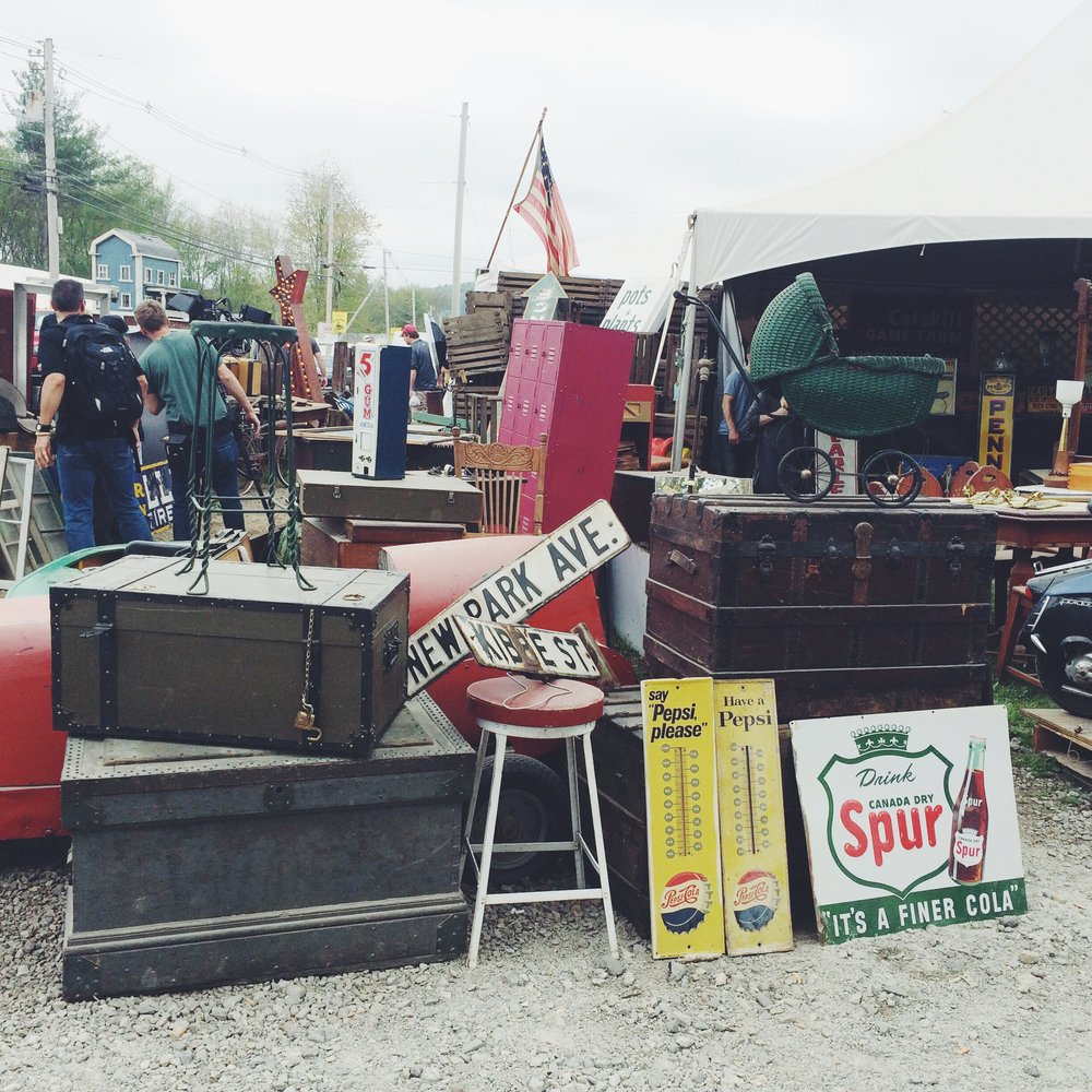Look all the way to the left. See the camera people? They were filming an episode of  Flea Market Flip !