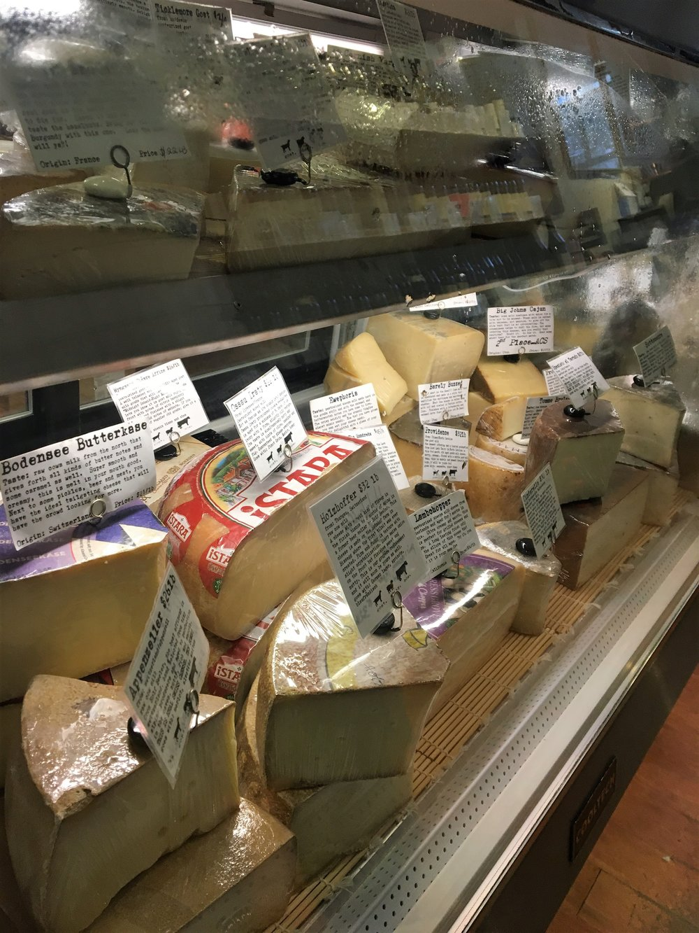 Look at this beautiful case of cheeses - pure heaven.