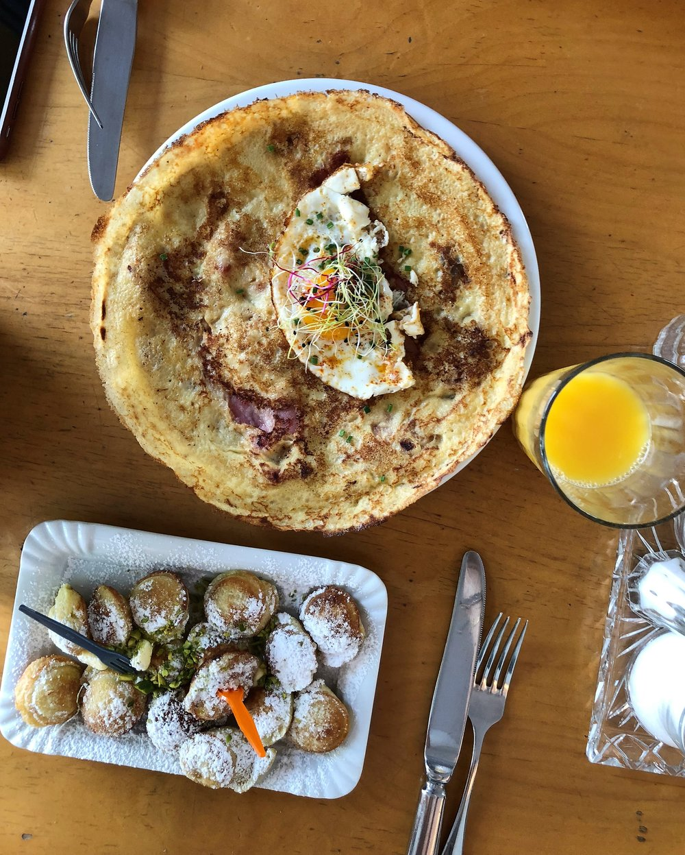 In Dan's research for brunch places, he found  Gasthaus Zum Gluten Gluck . I really liked the minimal cool decor complete with a sit in counter. The top dish is Dan's: pancake with bacon, onion and a fried egg. I went with the pufferli with butter and sugar (mini swiss pancakes).