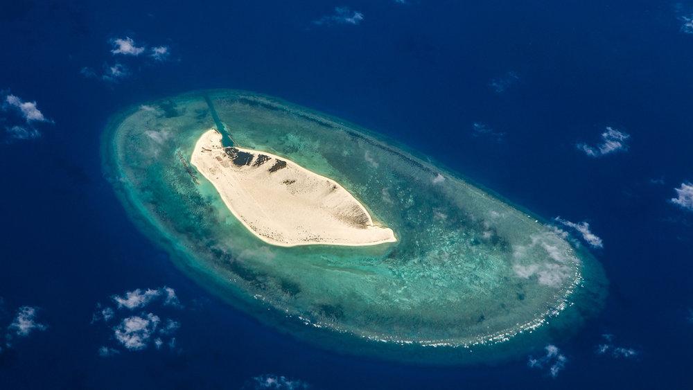 中國開始移除南海島礁部分設施。圖片來源:中國環球電視網